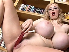 Horny librarian masturbates to books